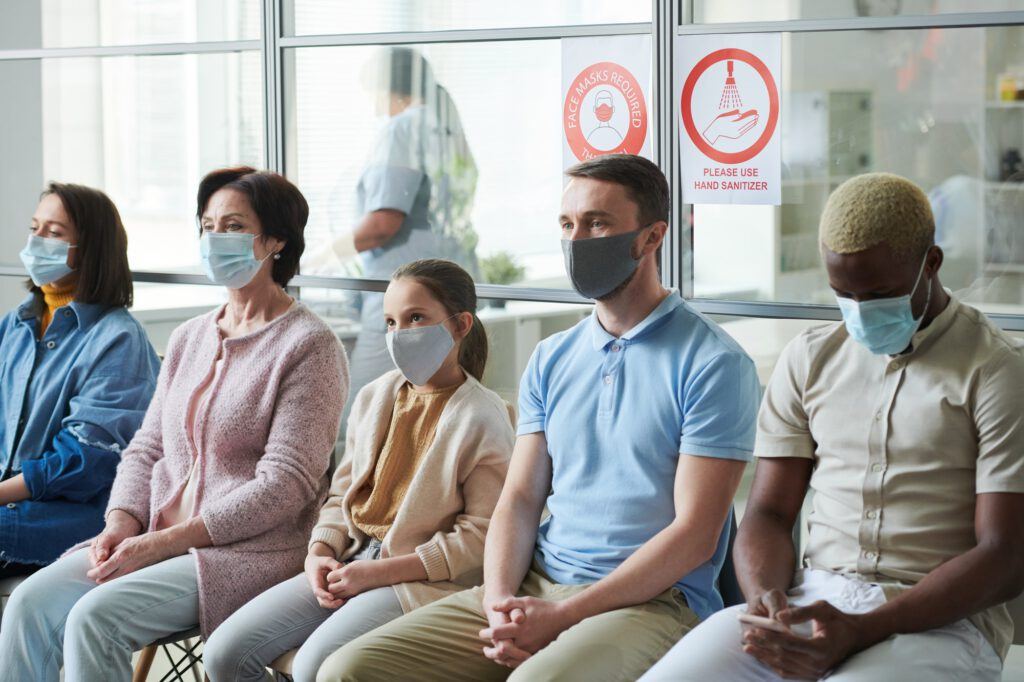 People in masks waiting for their turn to have vaccination against covid