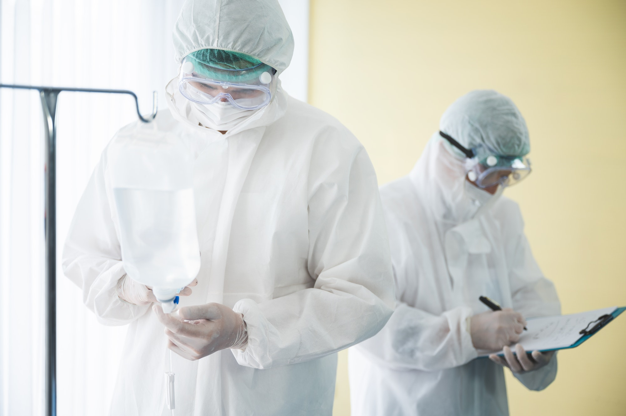 scientist doctor in PPE suit and goggles and mask to corona virus covid-19 protection