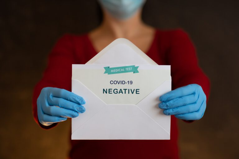 Woman Holding Negative Antigen Detection Test for Covid-19.